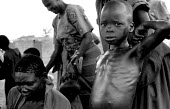 Acholi children in an IDP camp for Acholi displaced by the violent conflict waged between the Ugandan Government army - UPDF - and the Lords Resistance Army in northern Uganda for 20 years. More than... - Thomas Morley - 10-02-2005