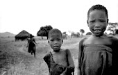 Acholi orphaned children continuing to live in their village despite the constant dangers from the LRA. Many Acholi have moved to IDP camps for displaced by the violent conflict waged between the Ugan... - Thomas Morley - 10-02-2005