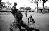 UPDF soldiers patrol close to an IDP camp for Acholi displaced by the violent conflict waged between the Ugandan Government army - UPDF - and the Lords Resistance Army in northern Uganda for 20 years.... - Thomas Morley - 18-02-2005