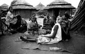 Acholi women living in an IDP camp for Acholi displaced by the violent conflict waged between the Ugandan Government army - UPDF - and the Lords Resistance Army in northern Uganda for 20 years. More t... - Thomas Morley - 18-02-2005