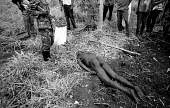 UPDF soldiers find the body of a villager who was one of three villagers abducted and killed by LRA rebels while they tried to protect their village from an attack. Gulu, northern Uganda 2005 - Thomas Morley - 2000s,2005,africa,african,Africans,armed forces,arms,Army,bodies,body,conflict,conflicts,crimes,developing,east,Gun,guns,Lords,military,rebels,Resistance,SERVICE,SERVICES,soldier,soldiers,UCW,uganda,u