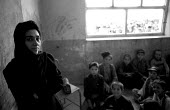 Woman teacher, newly trained, at an Afghan school reopened for girls and boys after the defeat of the Taliban. The school had been closed as it stood on the front line between the Taliban and Norhern... - Thomas Morley - 01-03-2002