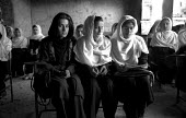 Afghan school reopened for girls and boys after the defeat of the Taliban. The school had been closed as it stood on the front line between the Taliban and Norhern Alliance forces and was partially da... - Thomas Morley - 01-03-2002