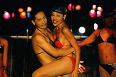 Ladyboys or kathoeys (Thai) at one of a number of popular cabaret shows in Bangkok. The term can simply refer to an effeminate gay male who dresses as a woman. But many of the males have full sex chan... - Tom Parker - 2000s,2007,3rd,ACE,Asia,asian,asians,Bangkok,Cabaret.,cities,city,cross,cross dressing,cross-dressing,culture,dance,DANCER,dancers,dancing,dress,dresser,dressers,dresses,dressing,EBF,Economic,Economy,