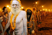 Pilgrims at the Kumbha Mela festival 2007, the largest gathering of people on the planet. 30 million Hindus and holy men known as Sadhus come to cleanse their sins in the Ganges River, Allahabad, Indi... - Tom Parker - &,2000s,2007,age,ageing population,Allahabad,Asia,asian,asians,bathe,Bathing,Belief,celebrate,celebrating,celebration,CELEBRATIONS,clean,cleanse,cleansing,conviction,elderly,event,faith,Festival,FESTI