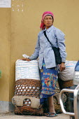 Hill Tribe woman at a market, in Northern Laos. - Tom Parker - 04-04-2007