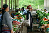 Hill Tribe woman shopping at a market, in Northern Laos. - Tom Parker - 04-04-2007