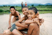 Boys play in the monsoon rain, northern Laos. - Tom Parker - 04-04-2007