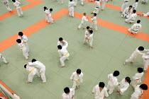 Judo training at the National Judo centre, Tokyo. - Tom Parker - ,2000s,2007,art,Asia,boy,boys,child,CHILDHOOD,children,combat,edu education,female,females,girl,girls,Japan,Japanese,Judo,judogi,judoka,juvenile,juveniles,kid,kids,LFL Leisure,male,martial,people,pers