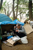 A homeless man outside his tent in Uneo Park, Tokyo. - Tom Parker - 04-04-2007