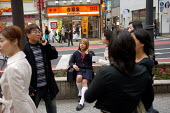 A transvestite man dressed as a school girl, Tokyo. - Tom Parker - 2000s,2007,Asia,cities,city,cross dressing,cross-dresser,cross-dressers,cross-dressing,dresser,dressers,dressing-up,flirt,flirting,gender,identity,Japan,Japanese,LFL Lifestyle,male,man,men,people,pers