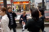 A transvestite man dressed as a school girl, Tokyo. - Tom Parker - 04-04-2007