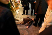 A passed out drunk man in Tokyo, alcohol abuse is an increasing problem in Japan. - Tom Parker - 04-04-2007