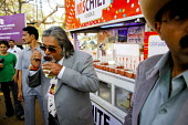 V J Mallya, tries a new Vodka drink - head of United Breweries and organiser of the The Mumbai Derby, where the citys rich and famous come to watch the horse racing and bet. Gambling in India is large... - Tom Parker - 2000s,2007,AFFLUENCE,AFFLUENT,alcohol,Asia,asian,asians,beverage,beverages,Bourgeoisie,celebrities,celebrity,communicating,communication,course,courses,drink,drinks,eat,eating,elite,elitism,EQUALITY,f