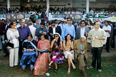 The Mumbai Derby, where the citys rich and famous come to watch the horse racing and bet. Gambling in India is largely illegal. - Tom Parker - 2000s,2007,AFFLUENCE,AFFLUENT,Asia,asian,asians,bet,bets,betting,Bourgeoisie,course,courses,elite,elitism,EQUALITY,equestrian,equine,fashion,fashionable,female,females,gamble,gambler,gambling,high,hig