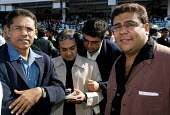 The Mumbai Derby, where the citys rich and famous come to watch the horse racing and bet. Gambling in India is largely illegal. - Tom Parker - 2000s,2007,AFFLUENCE,AFFLUENT,Asia,asian,asians,bet,bets,betting,Bourgeoisie,course,courses,elite,elitism,EQUALITY,equestrian,equine,gamble,gambler,gambling,glasses,group,groups,high,high income,horse