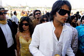 The Mumbai Derby, where the citys rich and famous come to watch the horse racing and bet. Gambling in India is largely illegal. - Tom Parker - 2000s,2007,adult,adults,AFFLUENCE,AFFLUENT,Asia,asian,asians,Bourgeoisie,couple,COUPLES,course,courses,dress,dressing up,elite,elitism,EQUALITY,equestrian,equine,fashion,fashionable,FEMALE,Gambling,hi