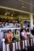 The Mumbai Derby, where the citys rich and famous come to watch the horse racing and bet. Gambling in India is largely illegal. - Tom Parker - 2000s,2007,AFFLUENCE,AFFLUENT,Asia,asian,asians,bet,bets,betting,Bourgeoisie,chair,chairs,course,courses,dress,dressing up,elite,elitism,EQUALITY,equestrian,equine,fashion,fashionable,FEMALE,females,g