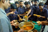 Workers eating together at Tata factory in Pune, the largest Indian car manufacturer, employing around 11,000 workers. Once simply a manufacturer of commercial trucks, Tata is now the 2nd most popular... - Tom Parker - 02-02-2007