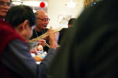 Chinese people eating on Chinese new year in the Chinese Old peoples' home, Cherish House (Hang Fook) in Digbeth, Birmingham - Timm Sonnenschein - 2000s,2004,asian,Birmingham,bme minority ethnic,BREAK,cantonese,chinese,chop,citizen,communities,community,Diaspora,dining,dinner,dinners,DINNERTIME,east,eat,eating,emigrant,emigrated,emigration,FEMAL