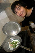 Chinese student steaming a fish in his home in Birmingham - Timm Sonnenschein - 29-01-2006