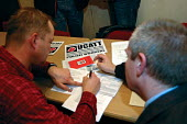 Polish worker signing up to become a UCATT member after a presentation at the Polish Club in Birmingham - Timm Sonnenschein - 2000s,2006,BAME,BAMEs,becoming,Birmingham,BME,bmes,Builder,Builders,club,clubs,construction industry,diversity,east,eastern european,ethnic,ethnicity,getting organized,interacting,interaction,joining
