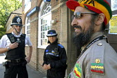 Partnership Patrol Scheme. Peace Officers of the Haile Selassie I Peace Foundation and West Midlands Police on the beat on Soho Road, Handsworth, Birmingham - Timm Sonnenschein - 03-08-2006