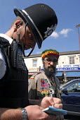 Peace Officers of the Haile Selassie I Peace Foundation and West Midlands Police on the beat on Soho Road, Handsworth, Birmingham - Timm Sonnenschein - 03-08-2006