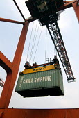 A container getting shipped at the Shanghai China Shipping Terminal in Pudong, Shanghai - Timm Sonnenschein - 15-08-2006
