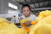 A girl working on a duck in the 'Toy Home' soft toy factory in Shanghai  � - Timm Sonnenschein - 01-09-2006