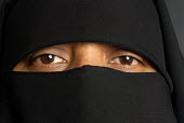 A Muslim woman wearing a niqab, Balsall Heath, Birmingham - Timm Sonnenschein - 2000s,2007,asian,Birmingham,black,cities,city,cover,covered,covering,dress,eye,eyes,face,faces,FEMALE,hajib,headscarf,headscarfs,hijab,islam,islamic,monotheistic,MUSLEM,muslim,muslims,niqab,niqabs,peo