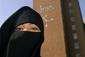 A Muslim student wearing a niqab on the Aston University Campus, Birmingham - Timm Sonnenschein - 2000s,2007,Asian,Birmingham,black,campus,CAMPUSES,cities,city,cover,covered,covering,dress,edu education,eye,eyes,face,faces,FEMALE,hajib,headscarf,headscarfs,Higher Education,hijab,islam,islamic,mono