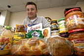 Polish shopkeeper Slawomir in his continental store Spichlerz with a range of Polish products, Erdington, Birmingham - Timm Sonnenschein - 2000s,2007,2nd,Birmingham,book,books,bought,bread,brezel,business,businesses,buy,buyer,buyers,buying,catholic,cities,city,commodities,commodity,consumer,consumers,corner shop,customer,customers,Diaspo
