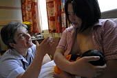 A midwife advising a young mother on breast feeding her new born baby, Birmingham Womens Hospital - Timm Sonnenschein - 22-06-2007