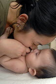 Chinese mother playing with her mixed race baby - Timm Sonnenschein - 2000s,2007,adult,adults,asian,asians,babies,baby,BAME,BAMEs,BME,bmes,child,CHILDHOOD,children,Chinese,diversity,EARLY YEARS,East,ethnic,ethnicity,Eurasian,families,FAMILY,female,females,girl,girls,hom