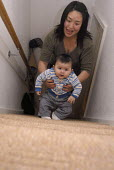 Chinese mother climbing up stairs with her mixed race baby - Timm Sonnenschein - 2000s,2008,adult,adults,Asian,babies,BABY,being,birth,born,child,childhood,children,Chinese,climb,climbed,climbing,EARLY YEARS,East,Eurasian,families,FAMILY,female,females,girl,girls,giving,infancy,in
