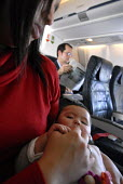 A mother comforting her baby girl during a flight - Timm Sonnenschein - 10-01-2008