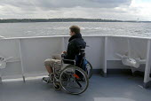 Young man in a wheelchair on a boat trip - Timm Sonnenschein - 13-08-2008
