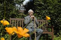 An elderly man enjoying the sun in a park in Birmingham - Timm Sonnenschein - 2000s,2008,age,aged,ageing population,bench,Birmingham,calm,cities,city,contemplation,elderly,enjoying,ENJOYMENT,flower,flowering,flowers,garden,GARDENS,having,male,man,men,old,PENSION,PENSIONS,people