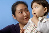 Chinese mother with her mixed race baby - Timm Sonnenschein - 30-08-2008