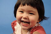 A young girl laughing - Timm Sonnenschein - ,2000s,2009,,mothers,adult,adults,asian,asians,at,BAME,BAMEs,BEMM,BEMMs,Black,BME,bmes,CARE,carer,carers,child,child care,child children,childcare,CHILDHOOD,CHILDMINDING,children,Chinese,diversity