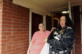 Two young women with a kitten on a council estate in Ladywood. Ladywood has the highest level of poverty in the UK - Timm Sonnenschein - 02-09-2009