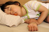 A young girl asleep sucking a dummy - Timm Sonnenschein - 2000s,2009,Asian,asleep,BAME,BAMEs,bed,beds,BME,bmes,child,CHILDHOOD,children,Chinese,closed,closing,closure,closures,diversity,dummies,dummy,EARLY YEARS,East,ethnic,ethnicity,EXHAUSTION,eye,eyes,fami