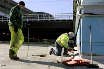 Workers doing maintenance work at a tram bridge, Snowhill �Birmingham - Timm Sonnenschein - 2010,2010s,contractor,Birmingham,bridge,building,BUILDINGS,capitalism,capitalist,cities,city,construction,Construction Industry,CONTRACTOR,Contractors,drill,drilling,EBF,Economic,Economy,employee,em