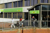 A mother with children entering the �Ladywood JobCentre Plus, Birmingham. Ladywood has the highest level of unemployment in the UK - Timm Sonnenschein - 08-03-2010