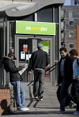 A man outside the �Ladywood JobCentre Plus, Birmingham. Ladywood has the highest level of unemployment in the UK - Timm Sonnenschein - 2010,2010s,Ladywood,agency,asian,asians,BAME,BAMEs,benefit,benefits,black,BME,bmes,centre,centres,cities,city,cultural,diversity,DWP,employee,employees,Employment,entering,ethnic,ethnicity,inner,job