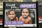 A Birmingham City Council Could you Adopt with Birmingham �advertisement board promoting adoption - Timm Sonnenschein - 2010,2010s,adopt,adoption,advert,ADVERTISED,advertisement,advertisements,advertising,ADVERTISMENT,adverts,BAME,BAMEs,Birmingham,black,BME,bmes,child,CHILDHOOD,children,cities,city,Council,Council Serv