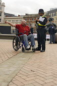 A disabled man asking a police officer for directions, Birmingham - Timm Sonnenschein - 24-03-2010