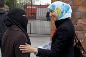 Salma Yaqoob, Respect Party, campaigning outside Conway School gates, Sparkbrook, Birmingham. - Timm Sonnenschein - 2010,2010s,BAME,BAMEs,Black,BME,bmes,burka,burkas,burqa,burqas,campaign,campaigning,CAMPAIGNS,CANVASING,canvassing,cities,city,communicating,communication,conversation,conversations,DEMOCRACY,dialogue