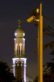Birmingham Central Mosque with a surveillance camera monitoring cars entering and leaving an area with a high Muslim population. Instaled by the Birmingham Safety Partnership and financed through a Ho... - Timm Sonnenschein - 19-06-2010